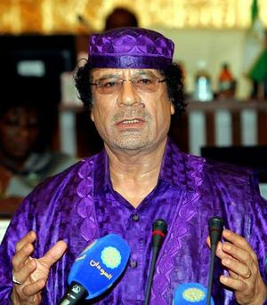 Muammar Gaddafi: Politics, Totalitarian. Fashion, Dior?