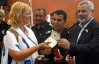Lauren Booth receives a Palestinian VIP passport from Hamas Prime Minister Ismail Haniya