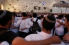 Jewish worshippers pray at the Kotel (The Western Wall) as they mark Tisha B'Av