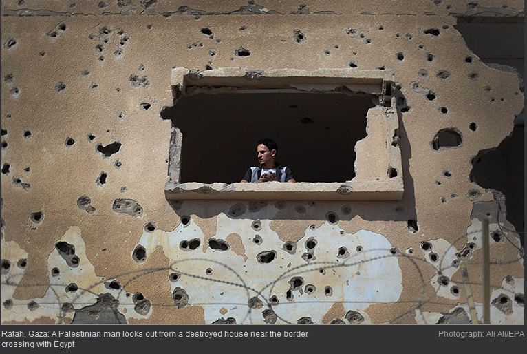 Photo journalist Ali Ali and a repeat Guardian photo of a destroyed home in Gaza