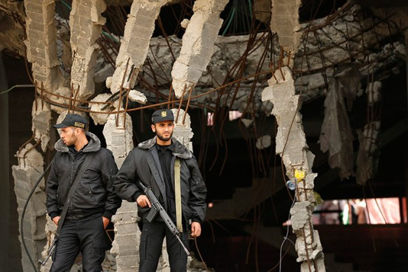 Members of Hamas security forces stand guard