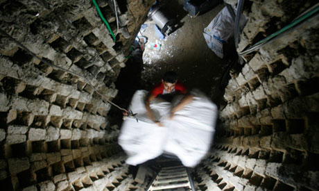 A Palestinian smuggler moves refrigerators through a tunnel from Egypt to the Gaza Strip under the border in Rafah, southern Gaza Strip. (Photo: AP)