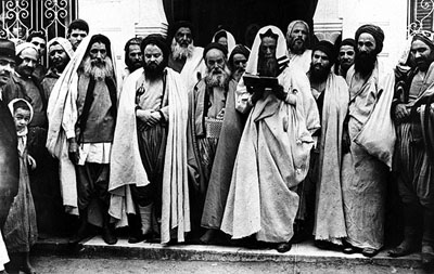 Rabbis at the entrance of El Ghriba synagogue Djerba, Tunisia, 1940's