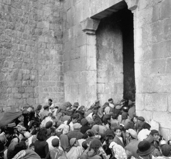 Expelled Jews shoved out of Zion Gate in the Old City of Jerusalem after the Arab conquest of 1948.