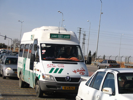 "An Arab shuttle bus travels on Highway 443, a road often incorrectly described as ""Jewish-only"" (Photo by Tamar Sternthal/CAMERA)"