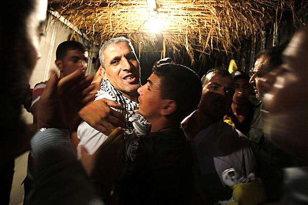 A freed Palestinian prisoner, one of 26 to be released, reaches the Gaza Strip Suhaib Salem/Reuters