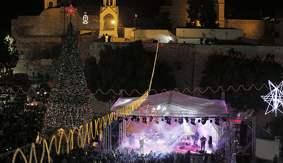 Musicians perform on stage in Manger Square, outside the Church of the Nativity, the site revered as the birthplace of Jesus, Bethlehem, Dec. 1, 2013.