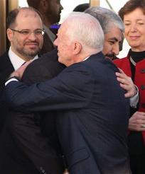 Jimmy Carter embraces Khaled Mashal