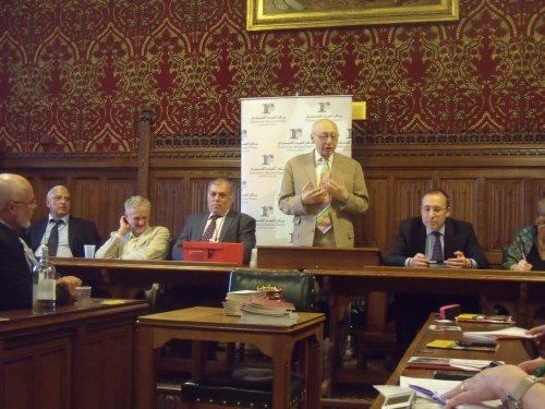 Corbyn (seated, white jacket) photographed by me at a Palestinian Return Centre event in 2012.